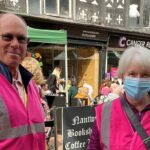 Volunteers in high visibility jackets
