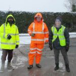 Volunteers at a car park during winter