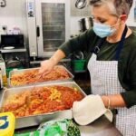 Chance Changing Lives volunteer stirring heated food