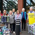 Chance Changing Lives volunteers outside a supermarket