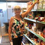 Chance Changing Lives volunteer stocking shelves