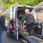 Wheelybus medical transport loading a passenger