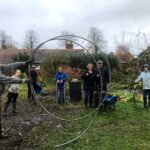 Volunteers working on the land and doing circus tricks for the camera